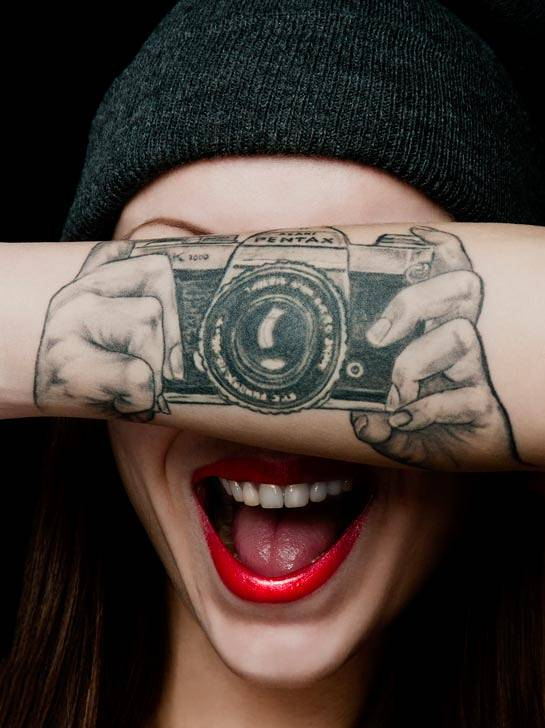 The Girl with the Camera Tattoo