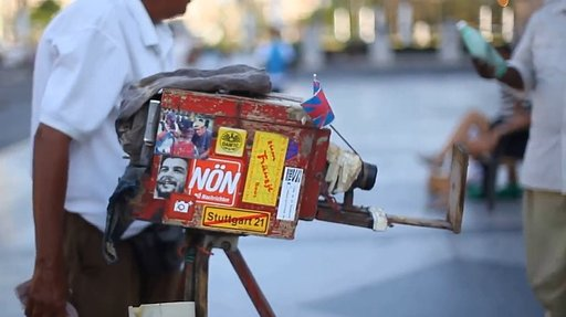 Cuban Street Photographer Using an Old-School Camera with a Built-In Darkroom